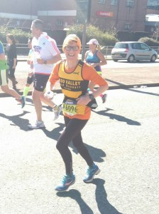 Debbie (minus shopping) looking strong at mile 25.
